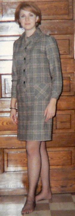 Karen Kline in front of sliding doors in her apt in Green Bay
